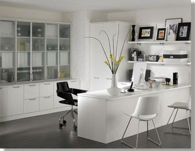 Contemporary Home Office with Interlocking Pavers, Built-in bookshelf, Standard height