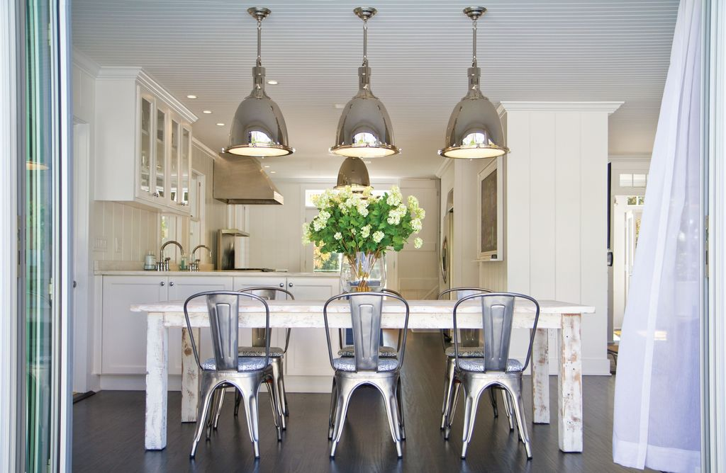 Contemporary Dining Room with Pendant light, Laminate floors, Paint, Standard height, Built-in bookshelf