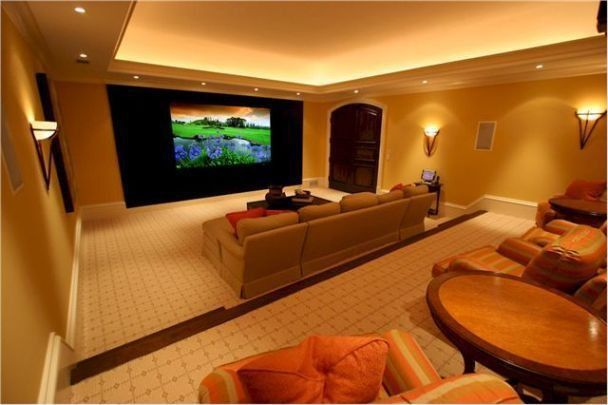 Contemporary Home Theater with Carpet, six panel door, Crown molding, Wall sconce, Paint, Standard height, can lights