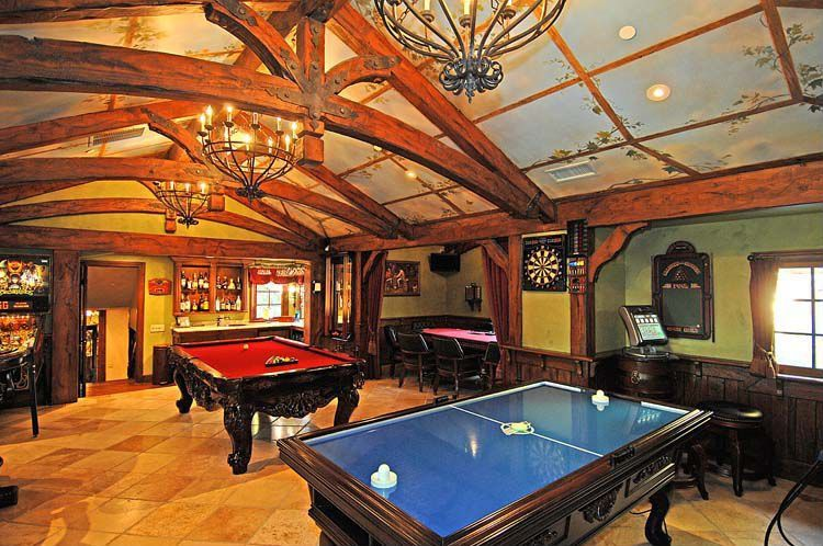 Traditional Game Room with Chandelier, Exposed beam, Chair rail, Casement, High ceiling, limestone tile floors, Wainscotting