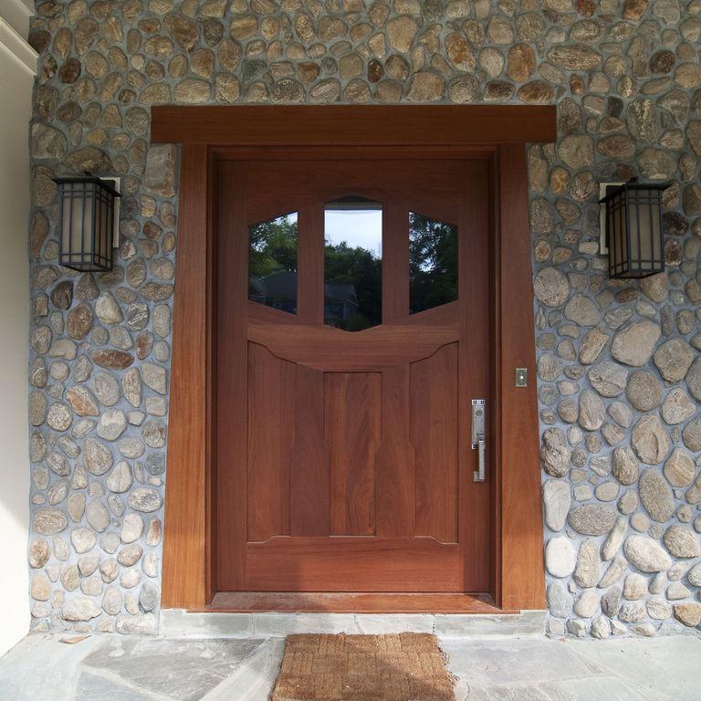 Craftsman Front Door with exterior stone floors, Glass panel door, River rock