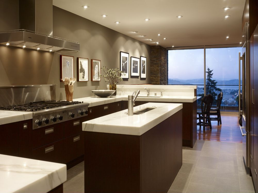 Contemporary Kitchen with Natural stone floors, Marble countertops, Engineered hardwood