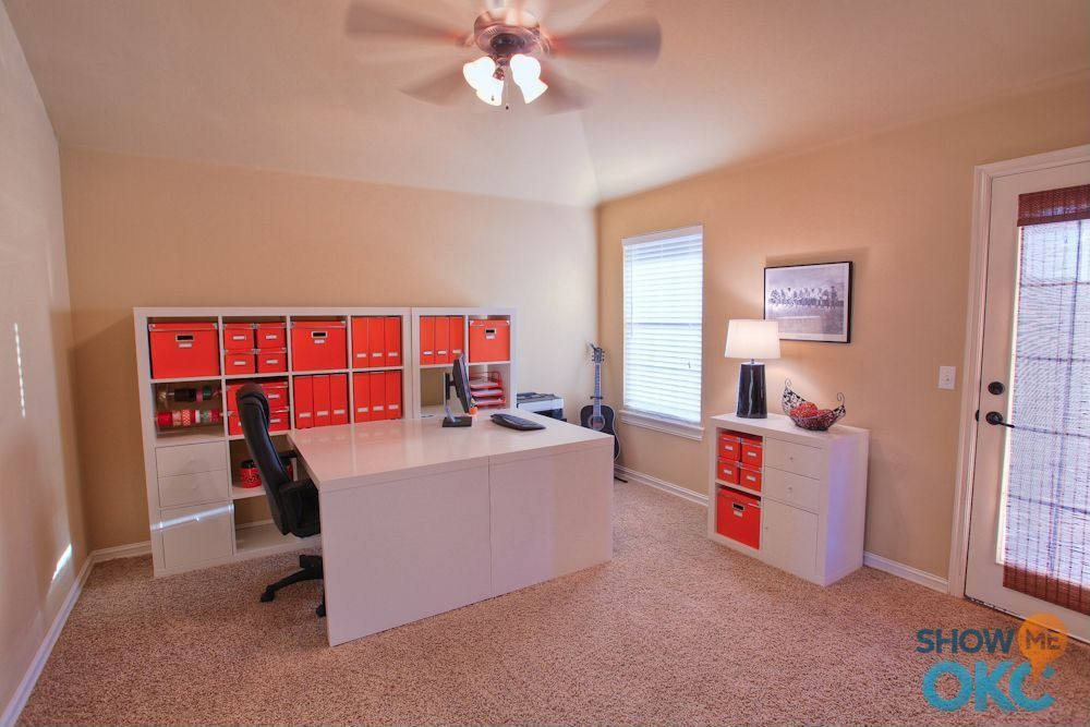 Contemporary Home Office with Ceiling fan, Glass panel door, double-hung window, Standard height, Carpet