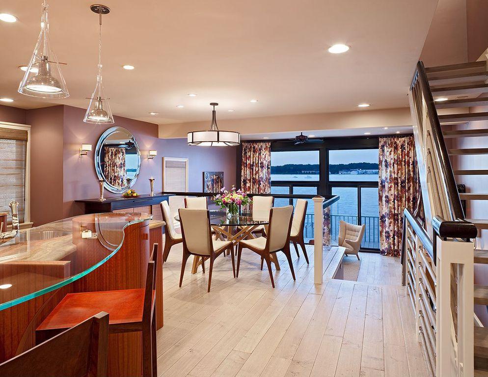 Modern Dining Room with Standard height, Wall sconce, flush light, Built-in bookshelf, can lights, Pendant light