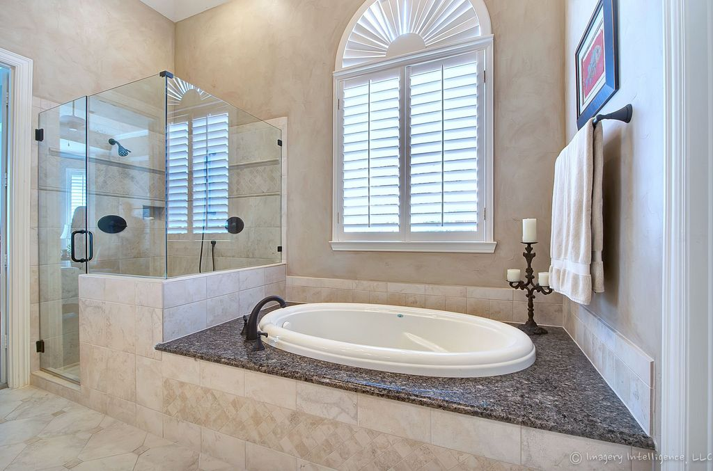 Traditional Master Bathroom with Oil rubbed bronze luxury shower system, Oval drop in bathtub, Drop in oval bathtub