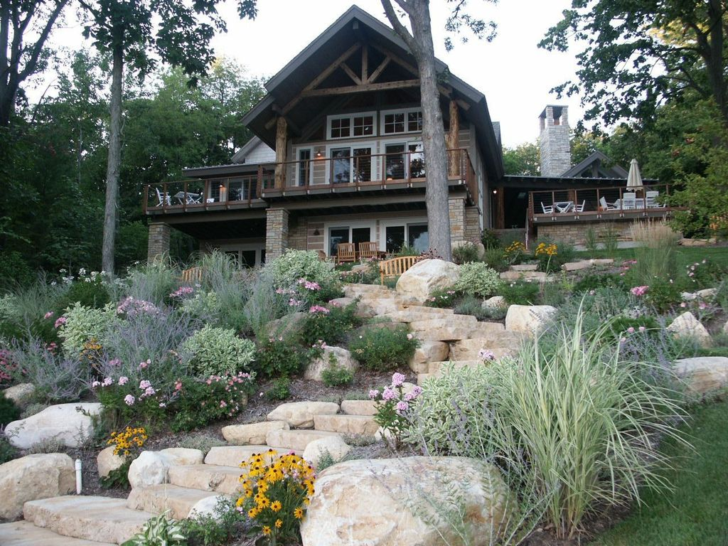 Country Exterior of Home with Hand chinked beams and posts, Exterior stone steps, Cabin, Appalachian style, Woodland setting