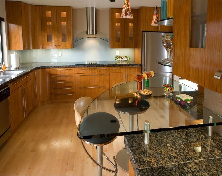 Contemporary Kitchen with can lights, Standard height, European Cabinets, Glass Tile, Glass panel, Pendant light, Wall Hood