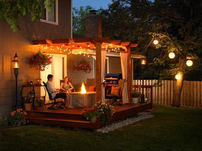 Traditional Patio with Outdoor kitchen, Wood pergola, Fire pit, sliding glass door, Casement, Fence, Trellis