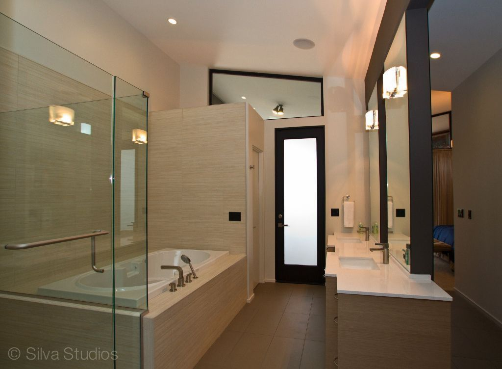 Contemporary Master Bathroom with stone tile floors, flush light, wall-mounted above mirror bathroom light, full backsplash