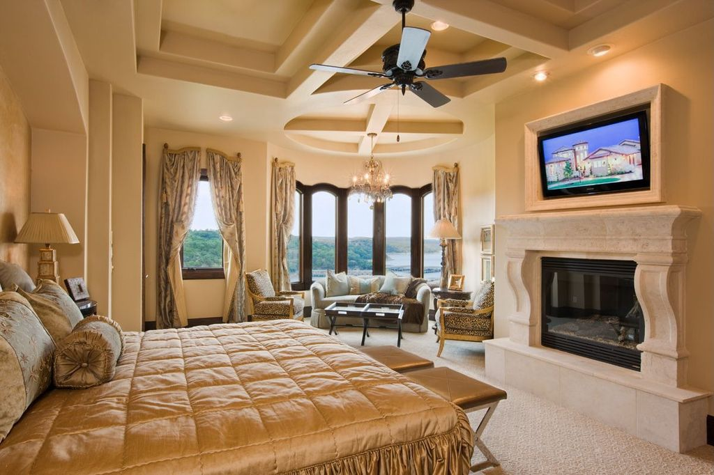Modern Master Bedroom with can lights, Standard height, picture window, stone fireplace, Eddie camel club chair, Chandelier