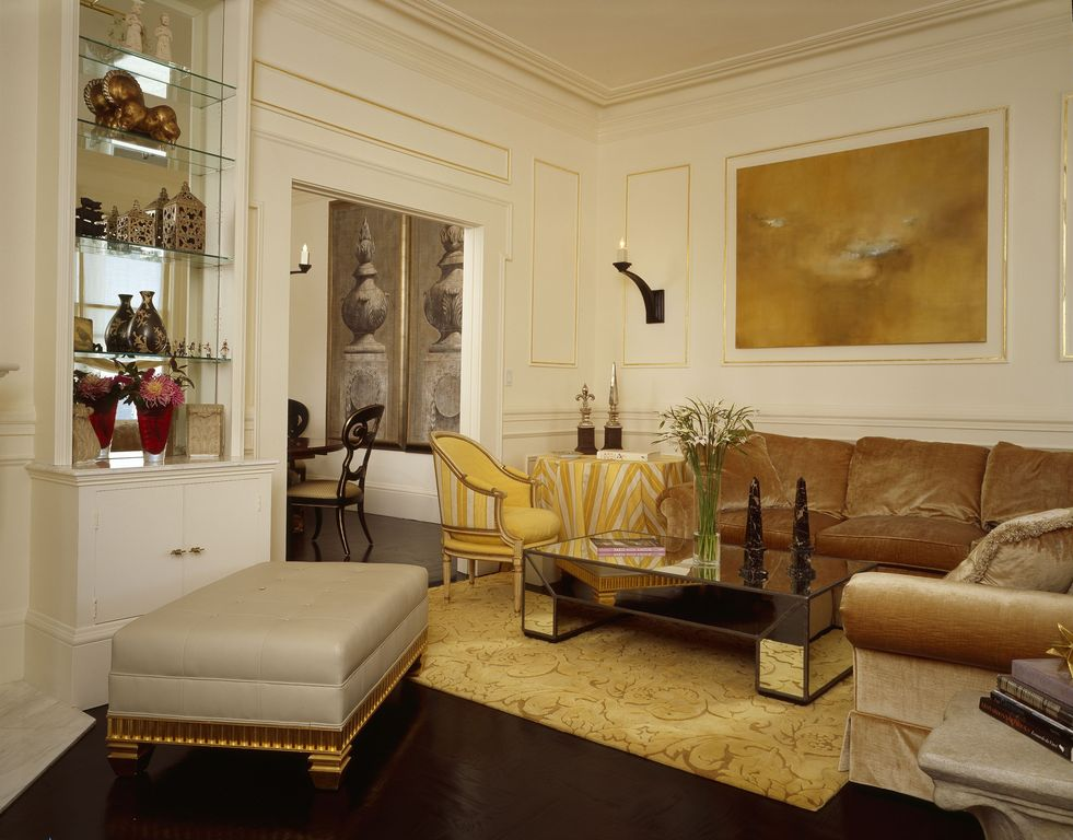 Contemporary Living Room with Standard height, Laminate floors, Crown molding, Wall sconce, Chair rail