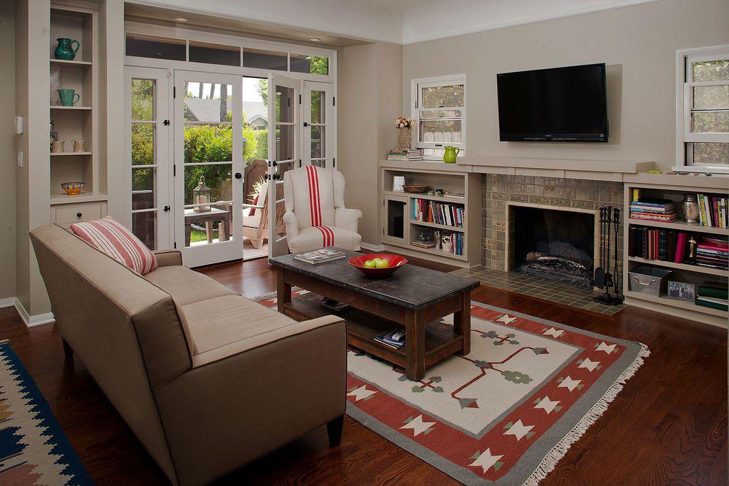 Eclectic Living Room with Hardwood floors, French doors, picture window, Built-in bookshelf, Standard height, Transom window