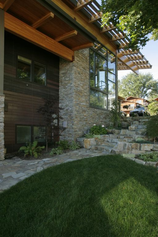 Contemporary Landscape/Yard with exterior stone floors, Trellis, picture window, Raised beds, Pathway