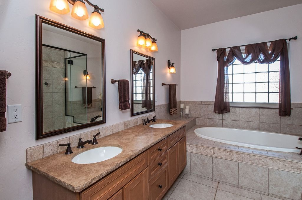Traditional Master Bathroom with Undermount sink, Master bathroom, Wall sconce, limestone tile floors, Limestone counters