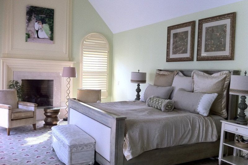 Traditional Master Bedroom with Arched window, Fireplace, brick fireplace, Standard height, Carpet, specialty window