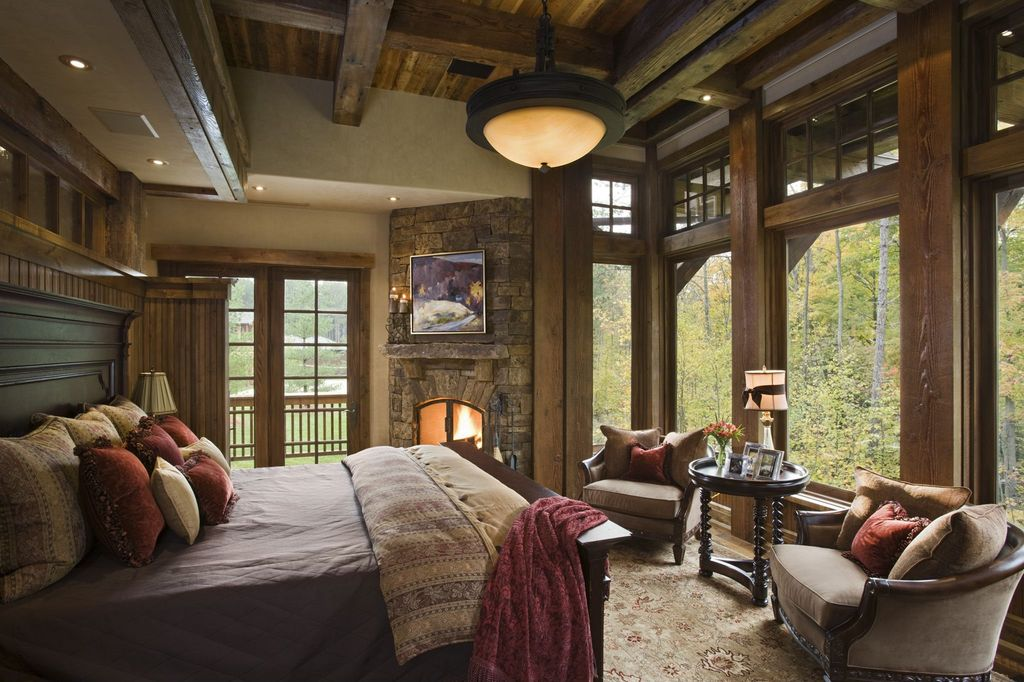 Rustic Master Bedroom with Exposed beam, Carpet, Paint, High ceiling, picture window, Paint, can lights, Natural wood framing