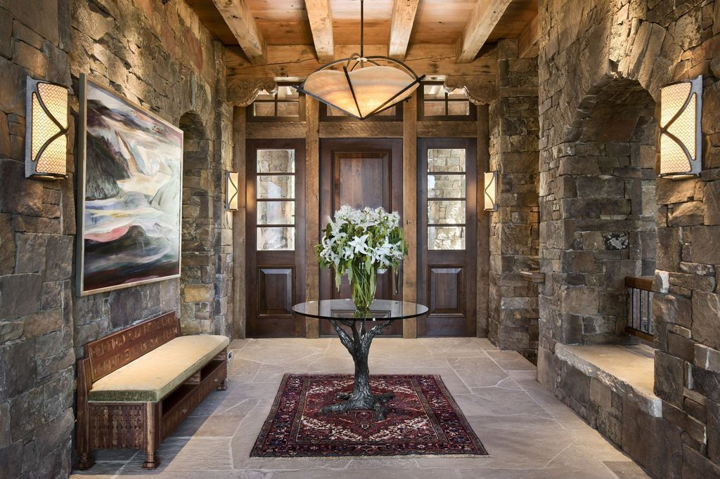 Rustic Entryway With Pendant Light By Locati Architects