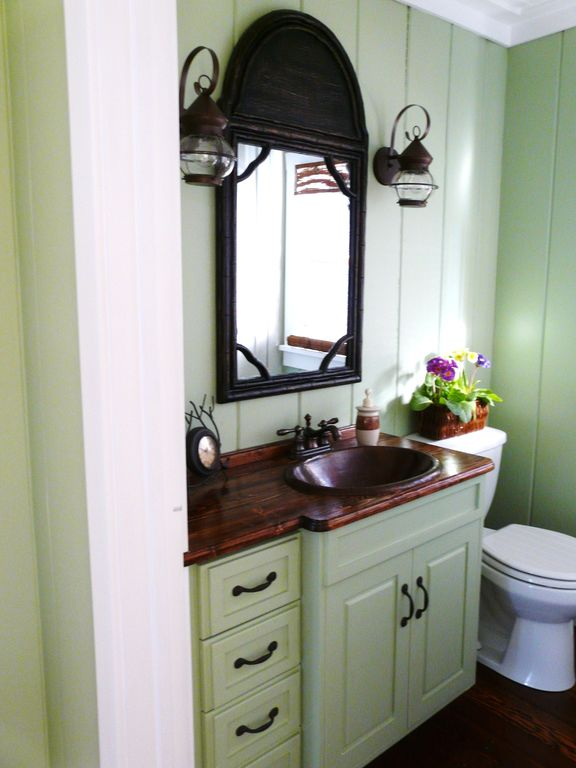 Cottage Powder Room with Framed Partial Panel, Flat panel cabinets, Powder room, Hardwood floors, drop-in sink, Wall sconce