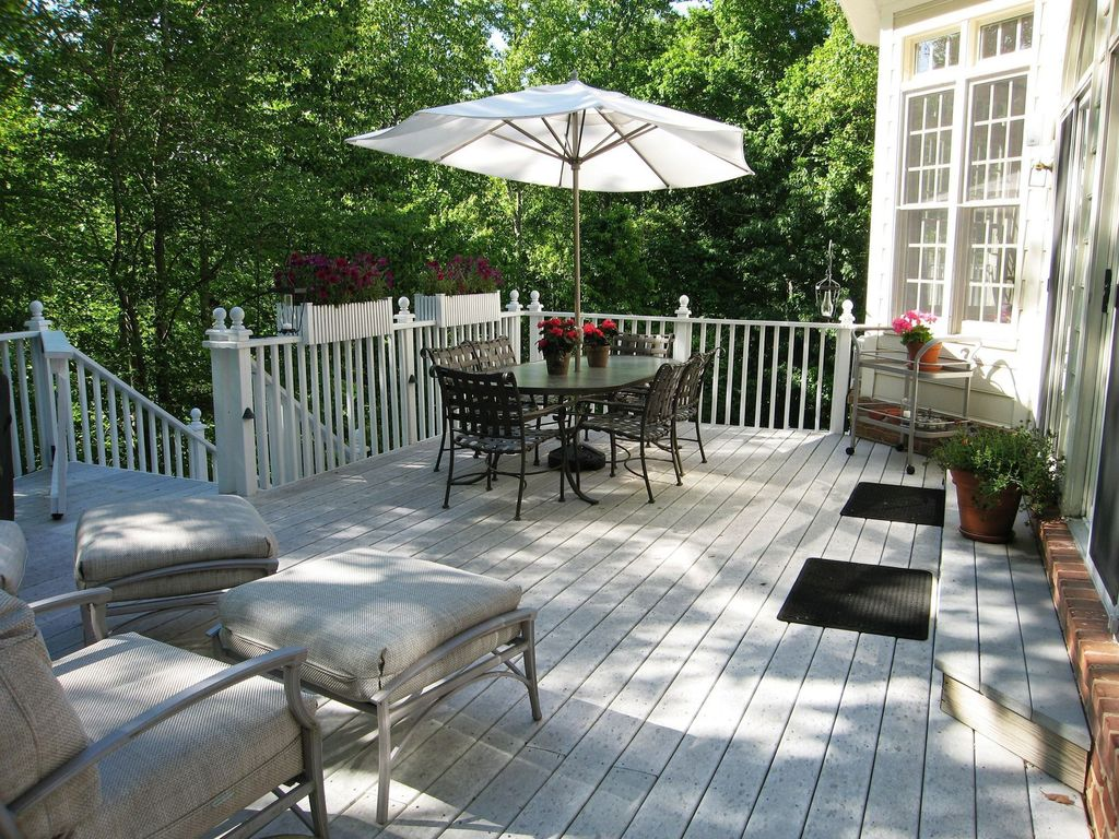 Traditional Deck with exterior brick floors, Transom window, Deck Railing, Casement