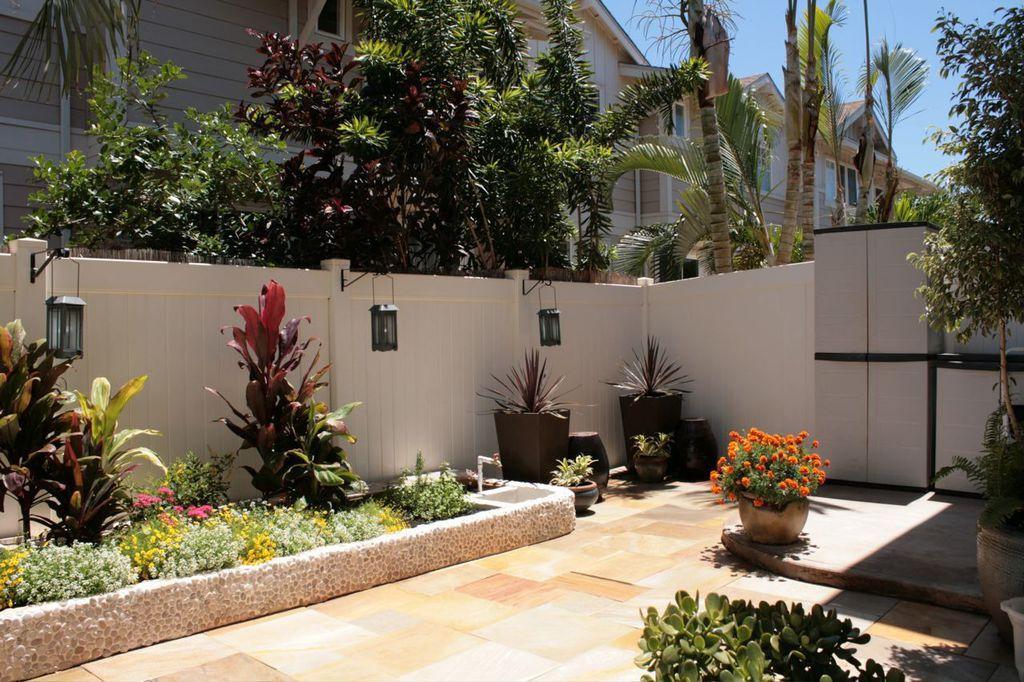 Mediterranean Landscape/Yard with Raised beds, exterior terracotta tile floors, exterior tile floors, Fence