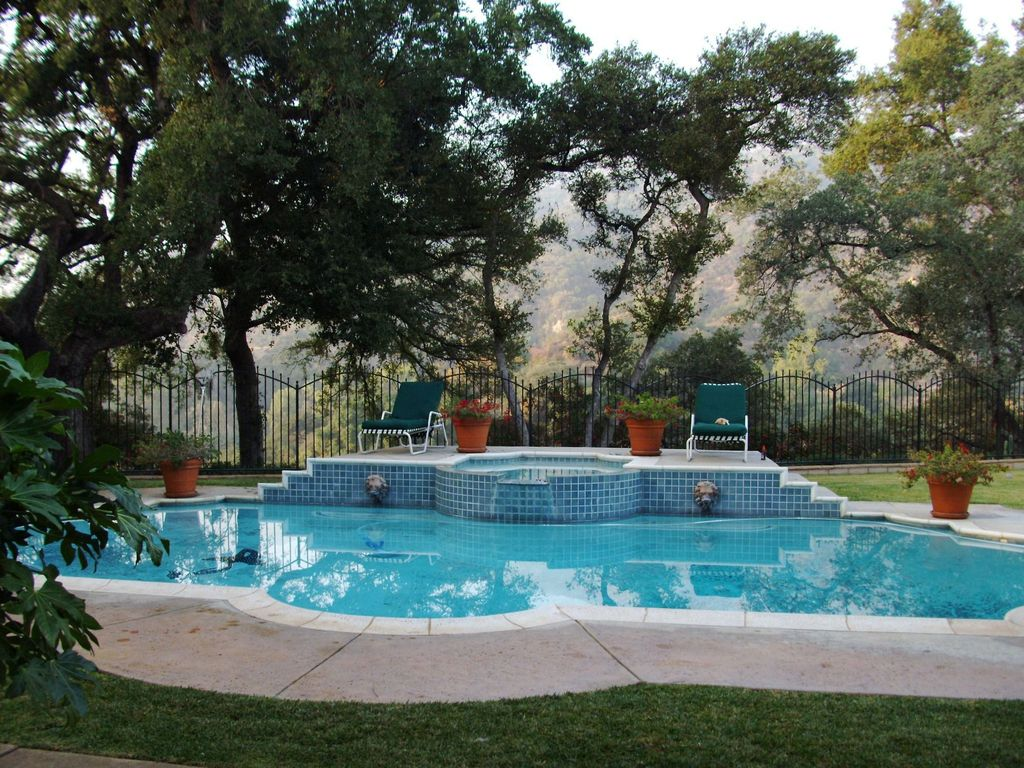 Traditional Swimming Pool with Pool with hot tub, exterior tile floors, Fence