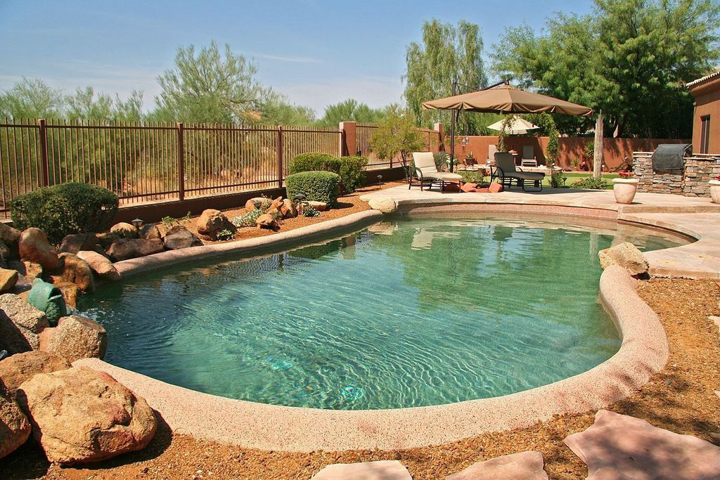 Rustic Swimming Pool with Other Pool Type, exterior tile floors, exterior concrete tile floors, Fence