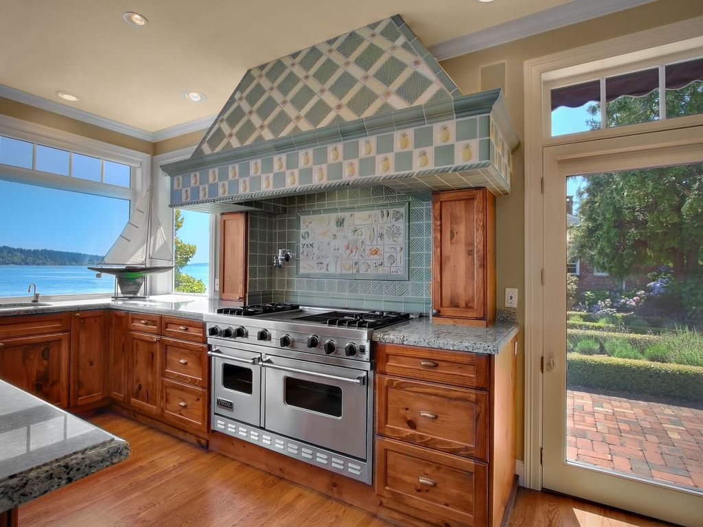 Cottage Kitchen with Flush, Specialty Tile, L-shaped, Undermount sink, Simple Granite, Mural, double oven range, can lights