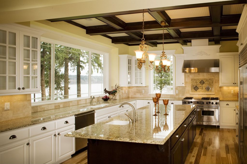 """Traditional Kitchen with double oven range, 4"""" travertine tile, Stone Tile, Multiple Sinks, Granite countertop, Glass panel"""