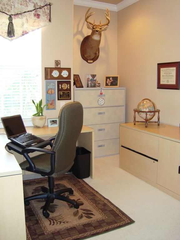 Contemporary Home Office with Crown molding, double-hung window, Standard height, Carpet