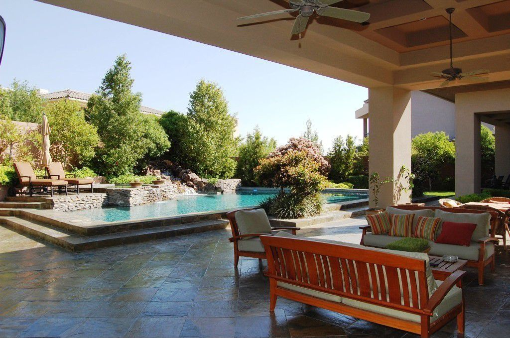 Mediterranean Patio with Fence, Fountain, exterior stone floors, Raised beds