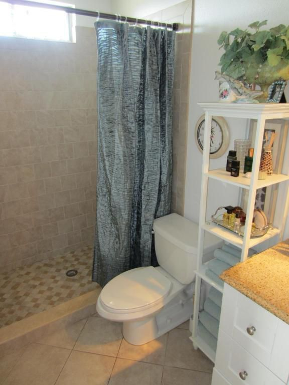 Traditional 3/4 Bathroom with Flat panel cabinets, three quarter bath, Shower, picture window, stone tile floors, Paint 1