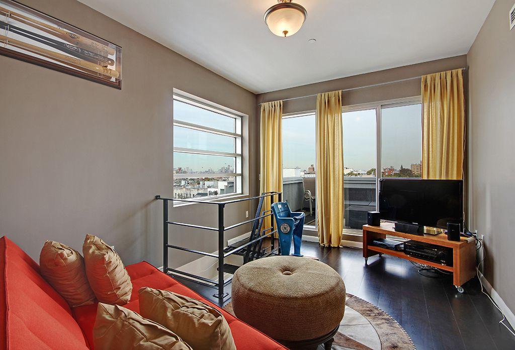 Contemporary Living Room with Hardwood floors, picture window, flush light, sliding glass door, Standard height