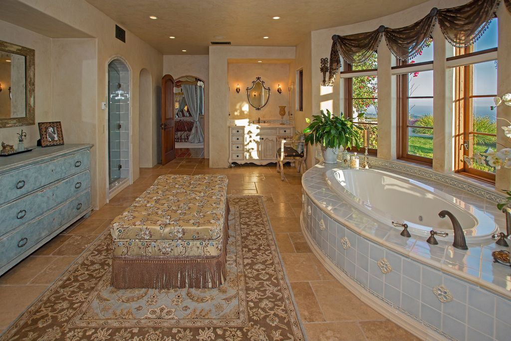 Traditional Master Bathroom with Raised panel, European Cabinets, limestone tile floors, frameless showerdoor, Wall sconce