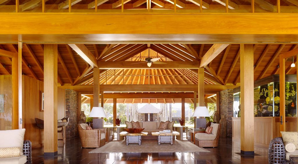 Tropical Living Room with flush light, Pendant light, Cathedral ceiling, Exposed beam, Ceiling fan, Wainscotting, Columns