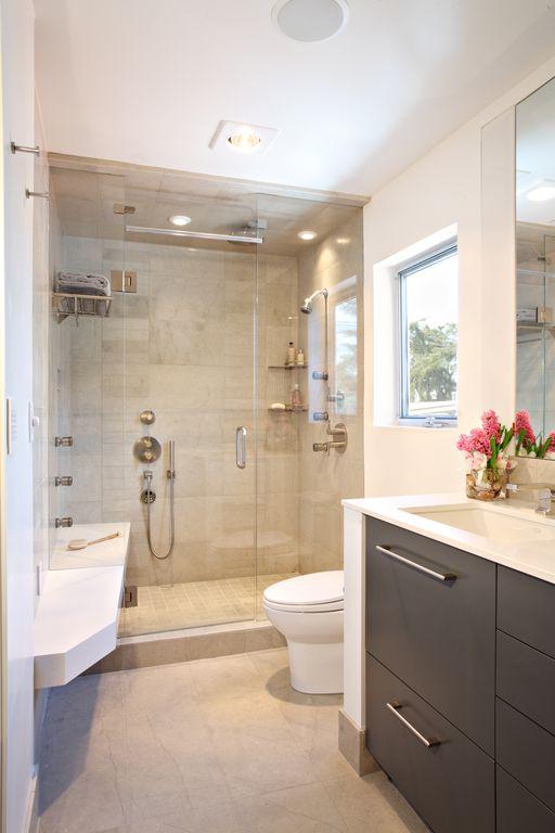 Contemporary 3/4 Bathroom with frameless showerdoor, Corian counters, stone tile floors, Wall Tiles, Flush, Shower, Casement