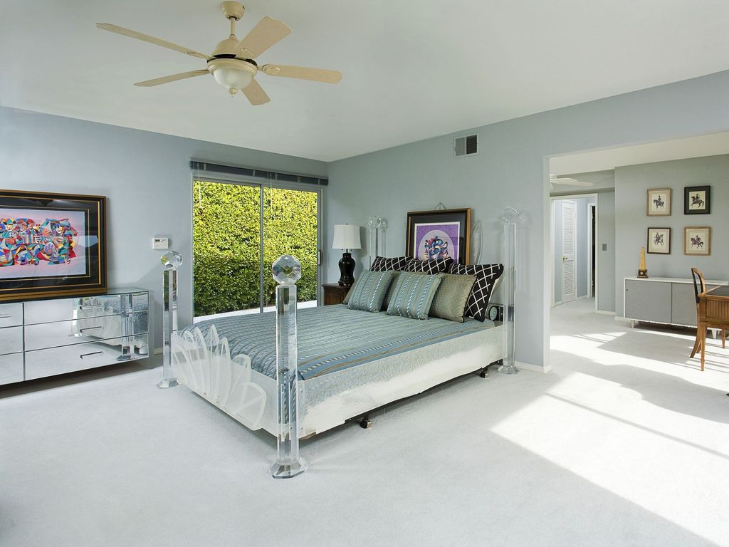 Contemporary Guest Bedroom with Standard height, sliding glass door, Ceiling fan, flush light, Carpet