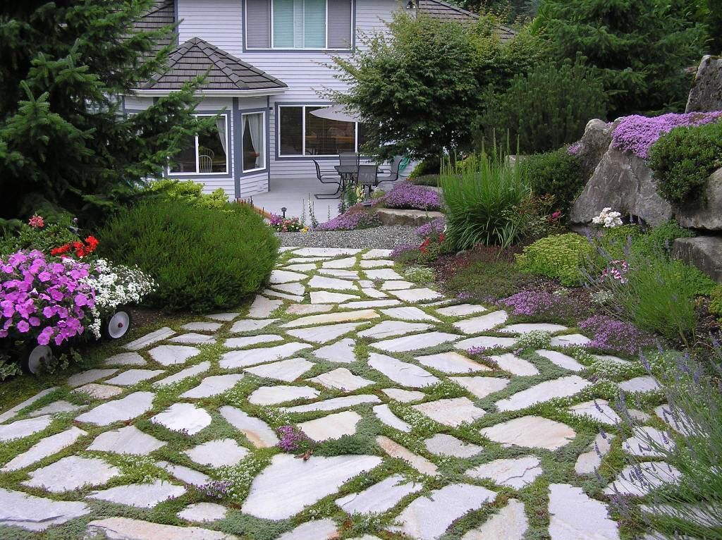 Traditional Landscape/Yard with exterior stone floors, exterior tile floors, Pathway, exterior concrete tile floors, Casement