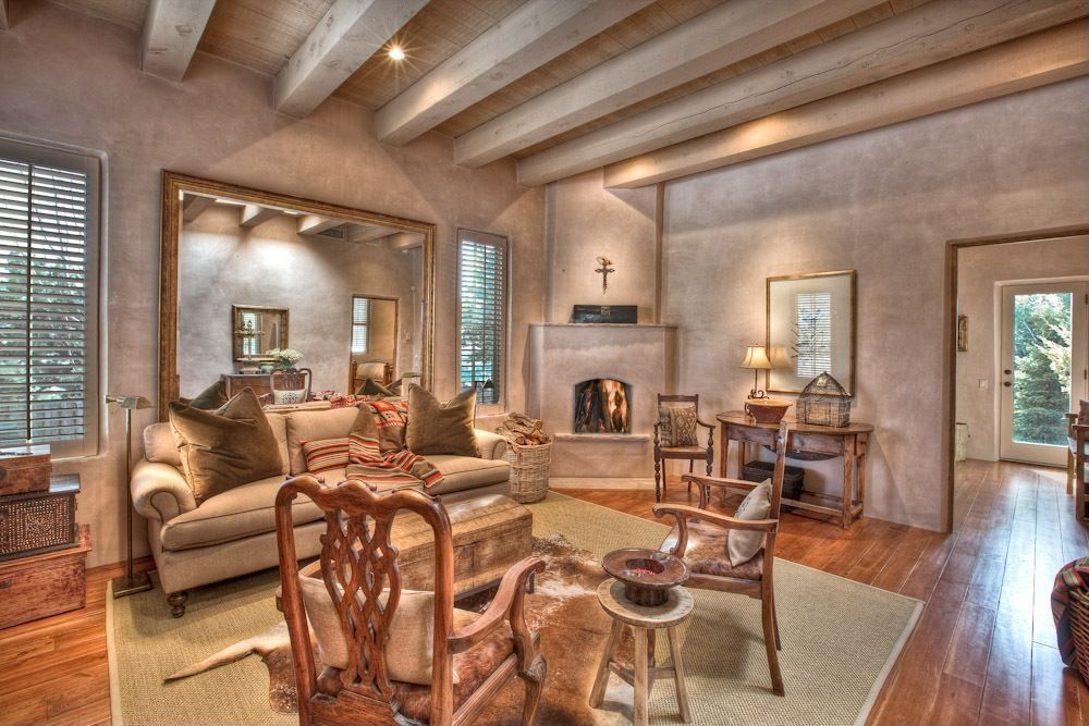 Eclectic Living Room with Exposed beam, Hardwood floors, Cement fireplace