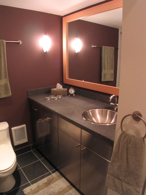 Full Bathroom with Stone Tile, European Cabinets, Drop-in sink, Paint, Wall sconce, Simple granite counters, Flush, Full Bath