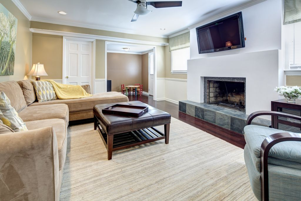 Contemporary Family Room with stone fireplace, Wainscotting, Ceiling fan, six panel door, Fireplace, Casement, can lights