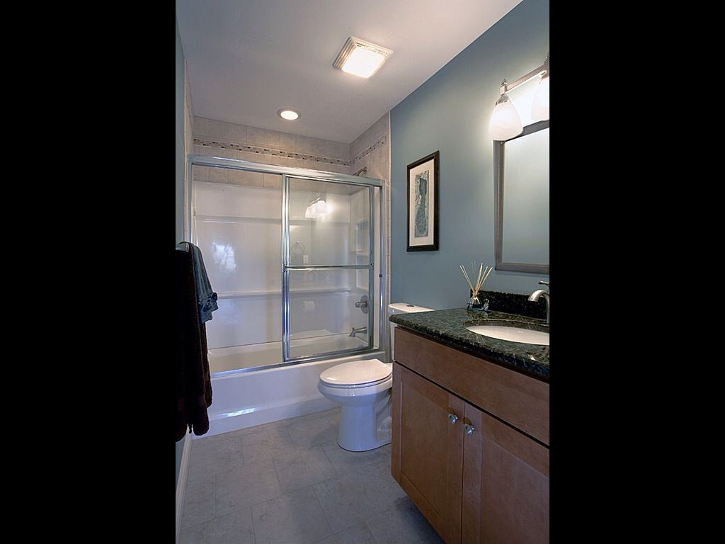 Contemporary Full Bathroom with Simple granite counters, European Cabinets, Flat panel cabinets, Undermount sink, flush light