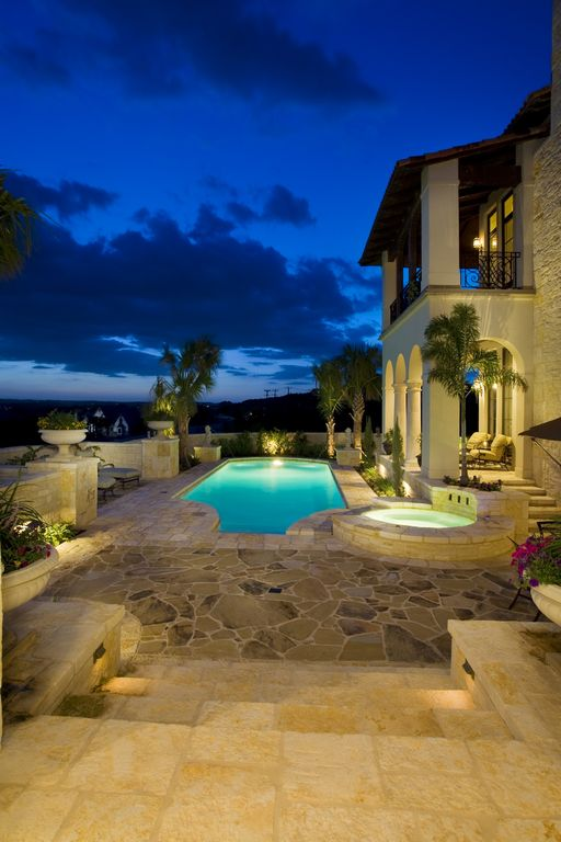Mediterranean Swimming Pool with Fence, French doors, Pool with hot tub, Transom window, exterior stone floors, Deck Railing