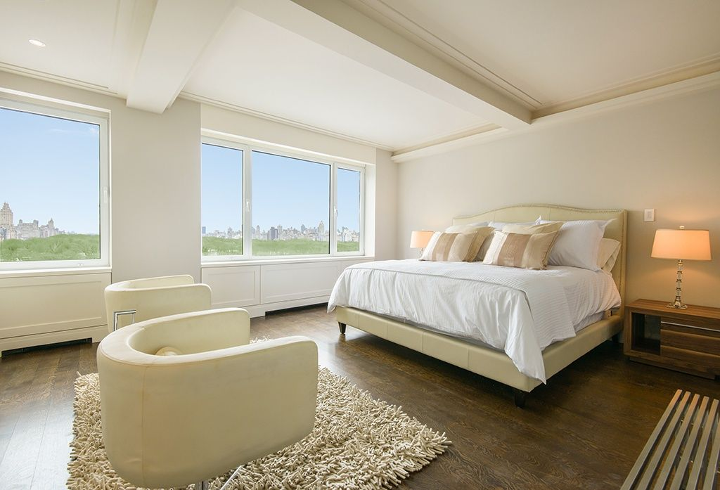 Contemporary Master Bedroom with picture window, Casement, Crown molding, Laminate floors, Exposed beam, Standard height