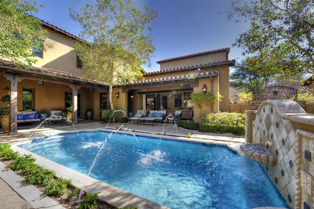 Mediterranean Swimming Pool with specialty window, Fountain, Fence, Other Pool Type, French doors, exterior stone floors