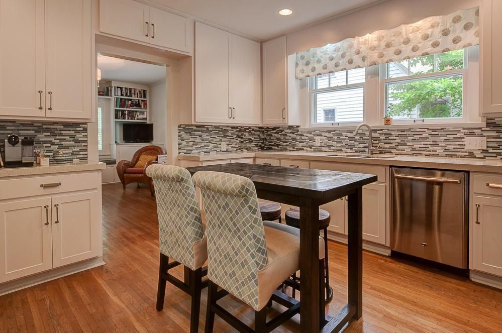 Contemporary Kitchen with Limestone counters, Breakfast bar, Kitchen island, Casement, Crown molding, Ceramic Tile, L-shaped