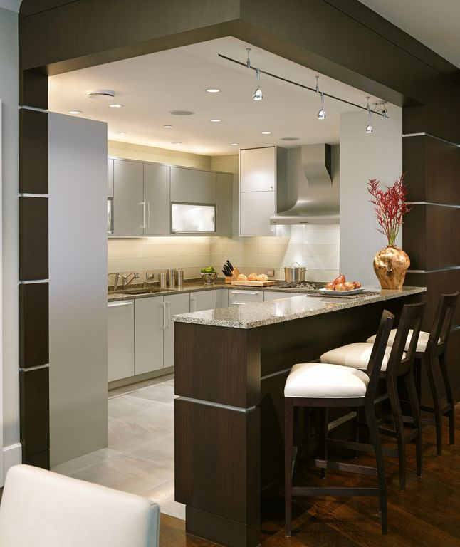 Contemporary Kitchen with partial backsplash, limestone tile floors, U-shaped, Breakfast bar, Simple granite counters, Flush