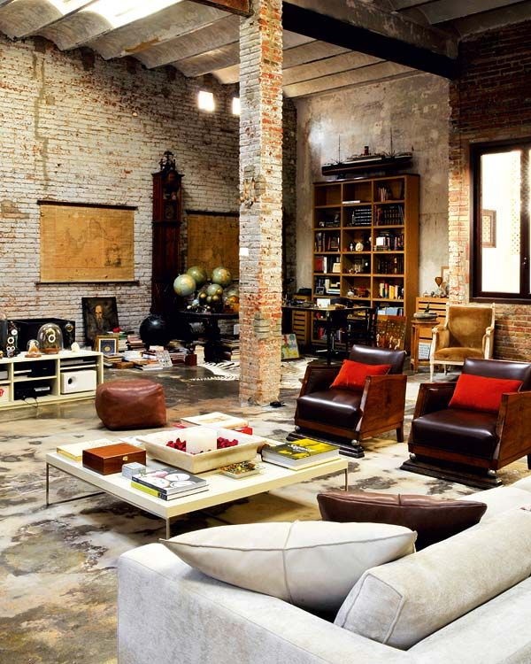Eclectic Living Room with Exposed beam, High ceiling, Columns, Built-in bookshelf, interior brick, Wall sconce