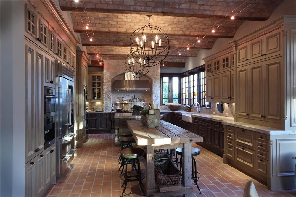 Eclectic Kitchen with Complex granite counters, Chandelier, Casement, double wall oven, High ceiling, Raised panel, Paint