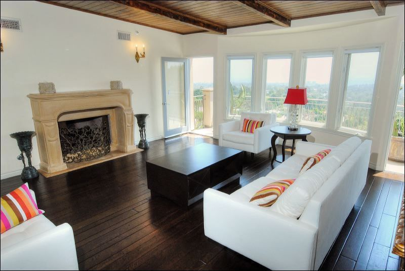 Traditional Living Room with metal fireplace, Casement, Standard height, stone fireplace, Wall sconce, Fireplace