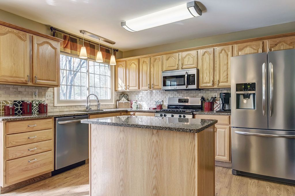 Traditional Kitchen with Kitchen island, flush light, Simple granite counters, L-shaped, Inset cabinets, Raised panel